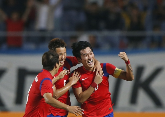 south-koreas-jang-hyun-soo-r-celebrates-with-teammates-after-scoring-the-first-goal-against-lebanon
