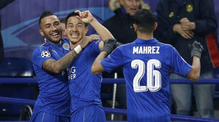 Leicester City's Shinji Okazaki celebrates scoring their first goal with Riyad Mahrez and Danny Simpson