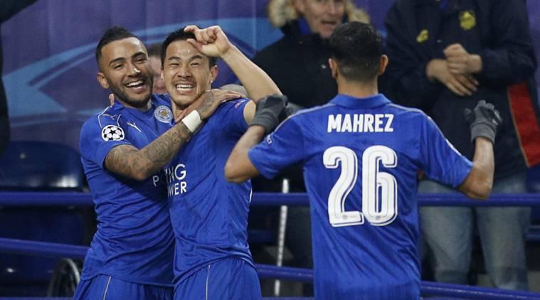 Leicester City's Shinji Okazaki celebrates scoring their first goal with Riyad Mahrez and Danny Simpson